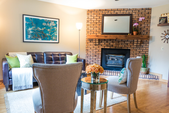 Home staging living room, home for sale, floor-to-ceiling brick fireplace
