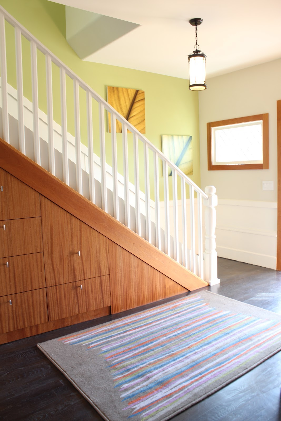 Don't want to commit to an entire accent wall? Then use one our favorite tricks -- painting the inside of a stairwell that's visible from your larger space instead!