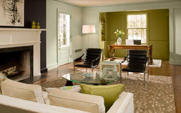The green accent color defines a separate space at the end of this long living room.