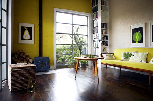 A bright pop of color can jazz up a basic rectangular room.