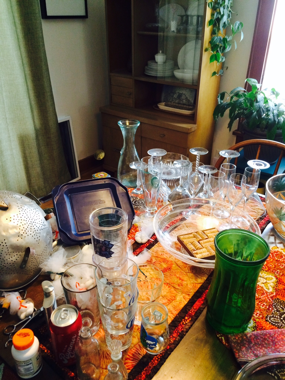 We have too much stuff! Here, our kitchen table is covered in clutter.