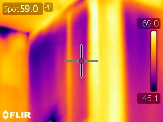 Thermal imaging in a bathroom, detecting air flow and leakage points. Photo by Steve Pipson