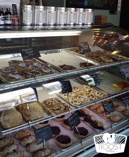 Inside Humble Pie with a display case full of delicious bakery items.