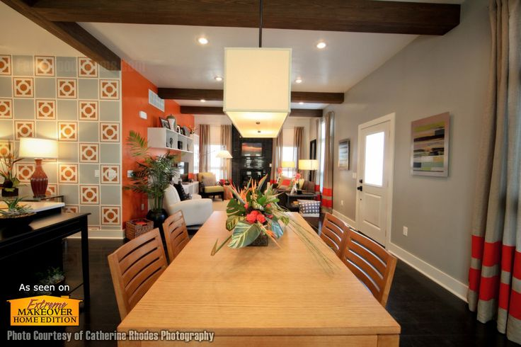 A modern dining room where wood beams are a complimentary feature.