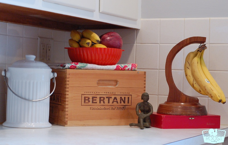 A variety of wood boxes and containers displayed on a kitchen counter.