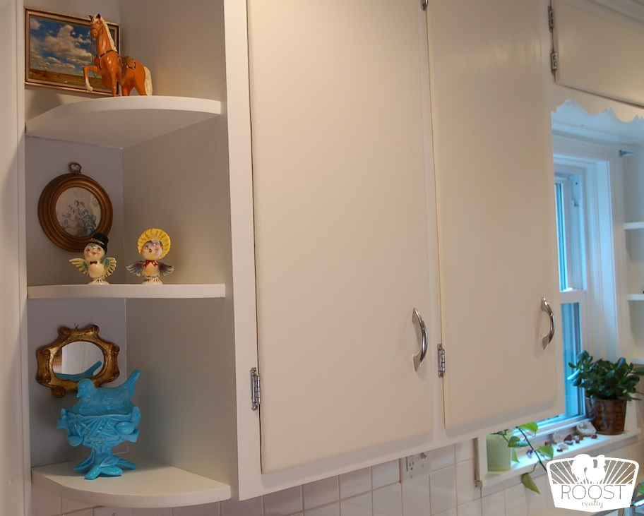 Built-in kitchen shelves holding vintage knick knacks.