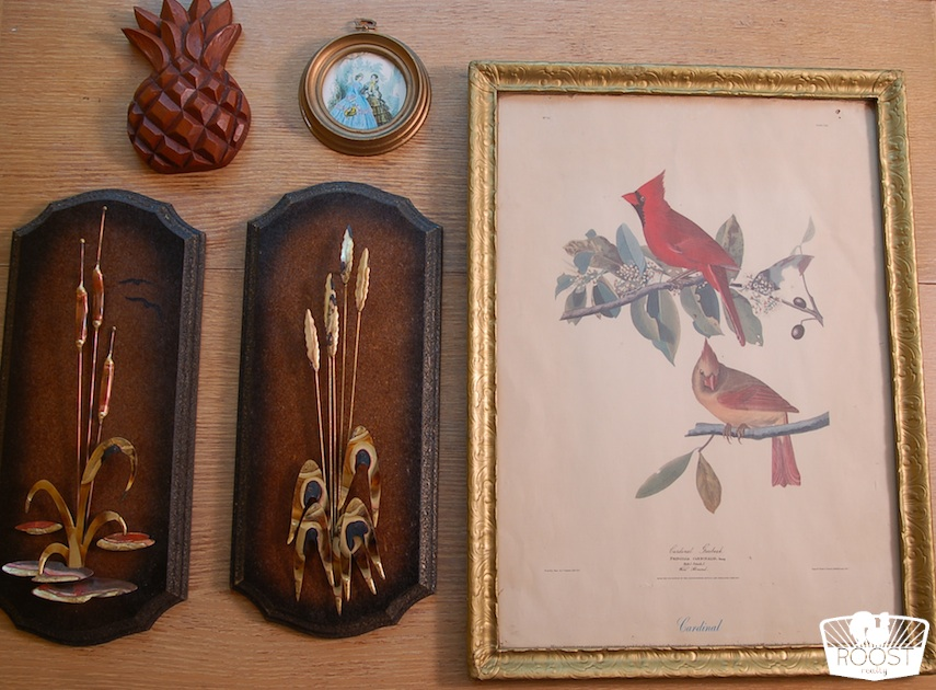 Six wall pieces hanging near each other on a wall.