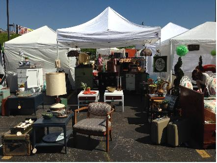 Vintage furniture outside of vendor tents.
