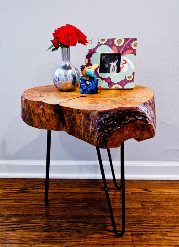 Tree trunk table top with black hairpin legs.