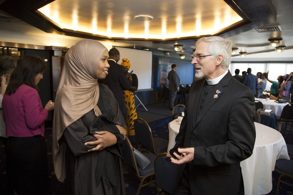 LIRS Pastor Mike Wilker speaks with a participant at the 2016 LIRS Migrant and Refugee Leadership Academy Credit Lisa Nipp.jpg