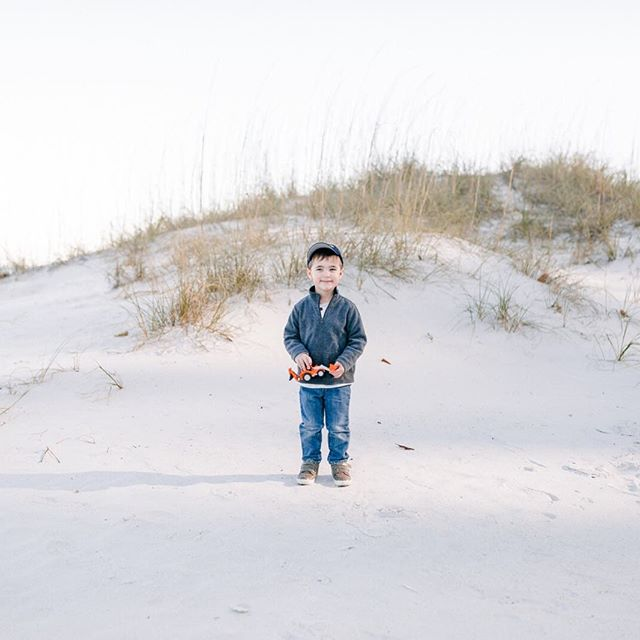 """Fighting colds today and dreaming about last week. In case you wondered if my kids have a case of the """"photographer's kid syndrome"""", they do. This one has already perfected his fake smile. Also, if he had a motto it would be """"Tractors. For now, for always."""""""