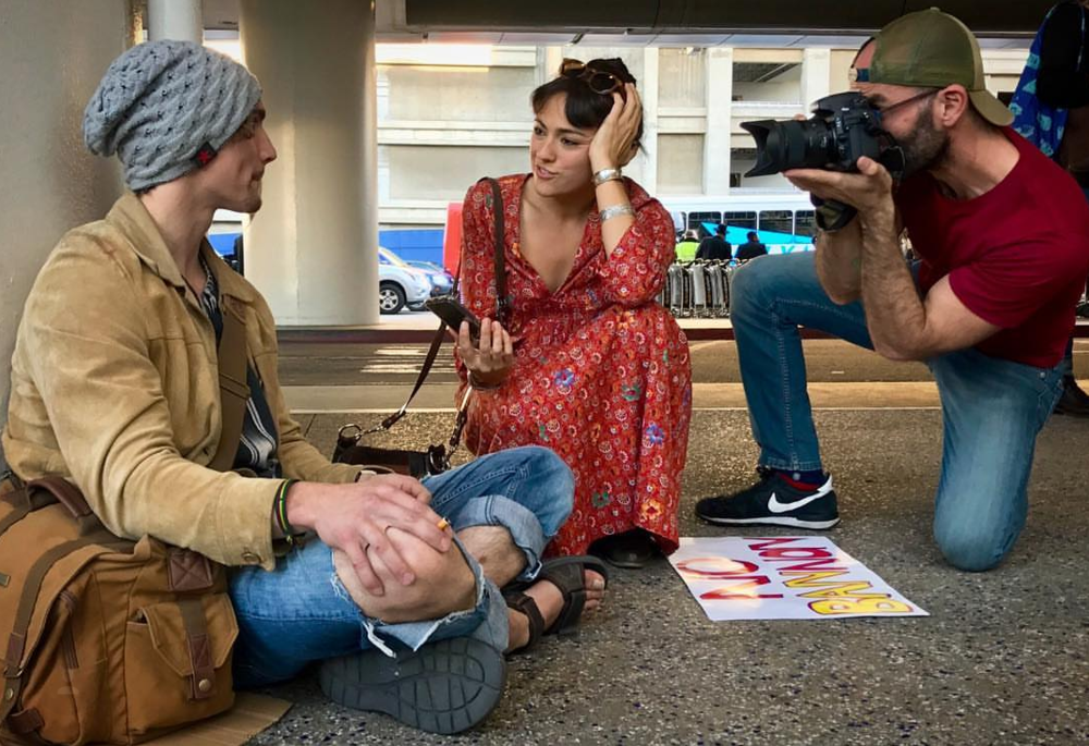Hanne and fellow AF Alum Zach Oren interviewing someone at the LAX protest against the seven nation no-fly list in January.