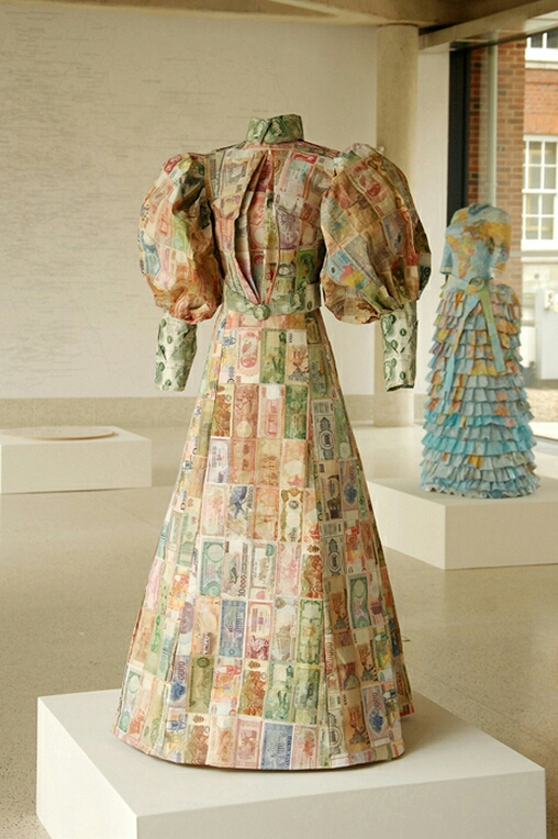 "Susan Stockwell  is an amazing British artist that uses technology, ecology and politics in her works while also incorporating recycled computer parts and other everyday materials. Here we have  ""The Money Dress""  which she designed and was made with paper money from all over the world. These particular style of dresses were inspired by the very ones worn by british Female Explorers in the 1870's....  from Shawn Lloyd's blog"