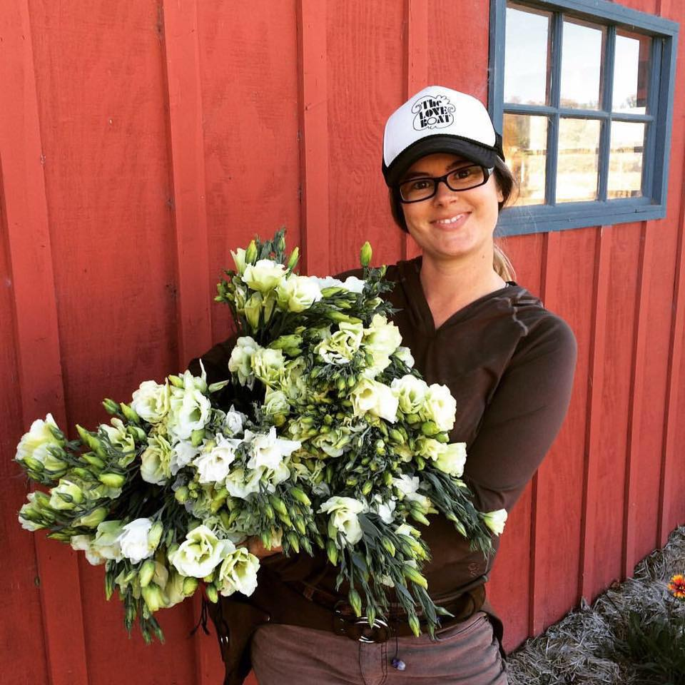 Daniele holding a few bunches worth of Chica Bloom Farm grown Lisianthus.