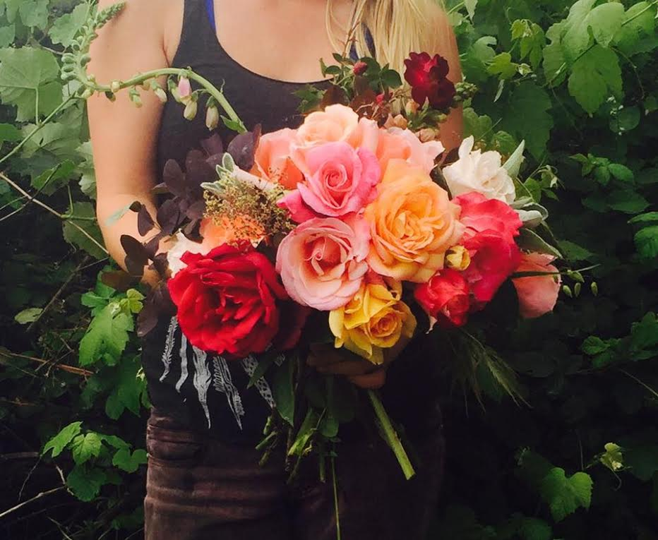 Picture of Hedda Brorstrom, of Full Bloom Flower Farm, with a beautiful bouquet she designed using a mix of our garden roses.