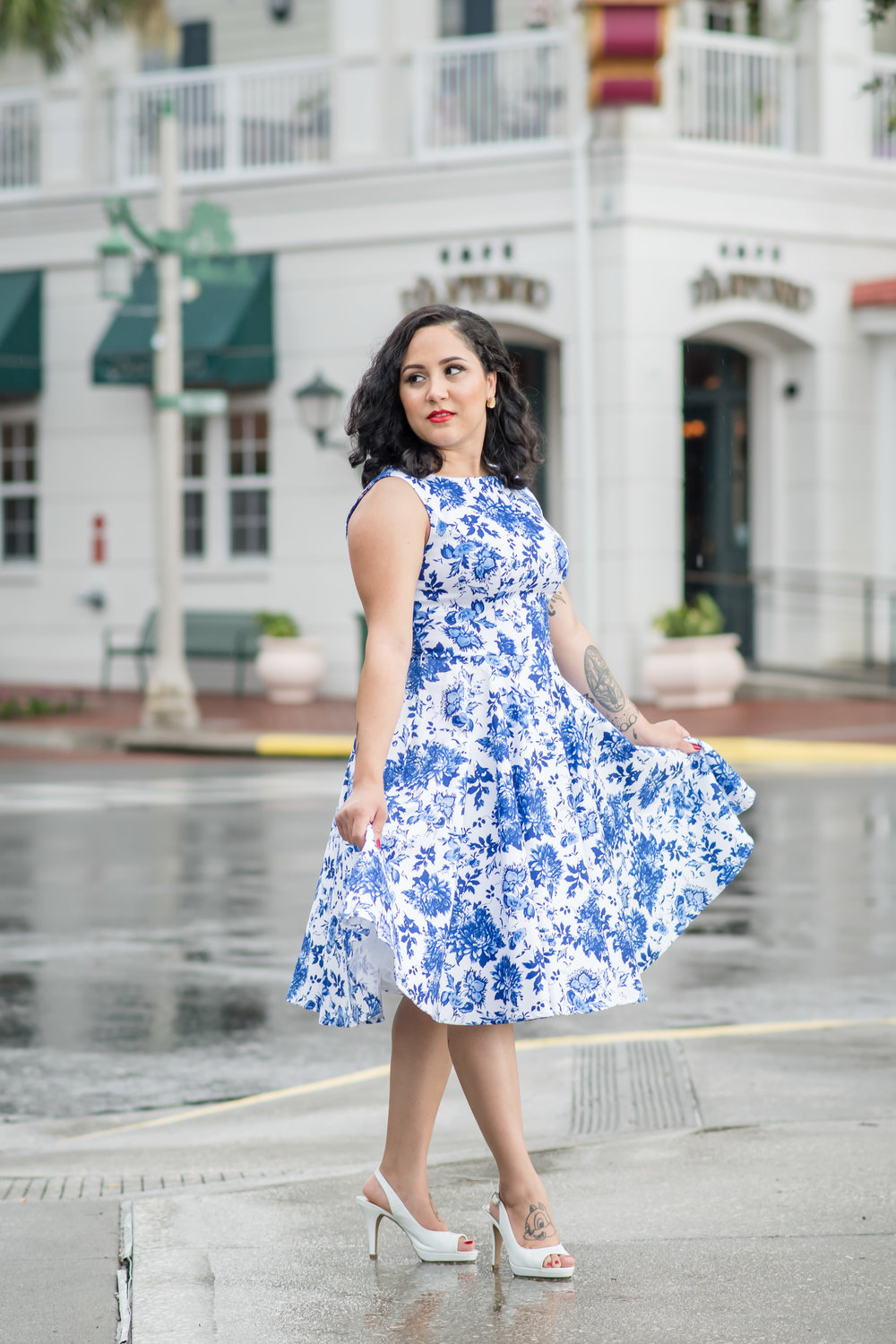 This gorgeous, and beautifully inked model, totally rocked her A-line dress, peep toe heels, and 1950's makeup and hairstyle.Totally in love with this vintage inspired shoot!