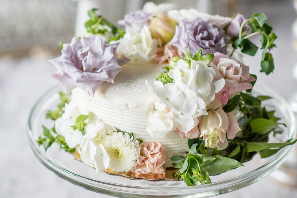 whimsical wedding cake with flowers