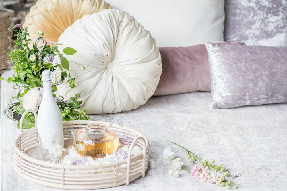 tea and champagne with lilac and beige pillows