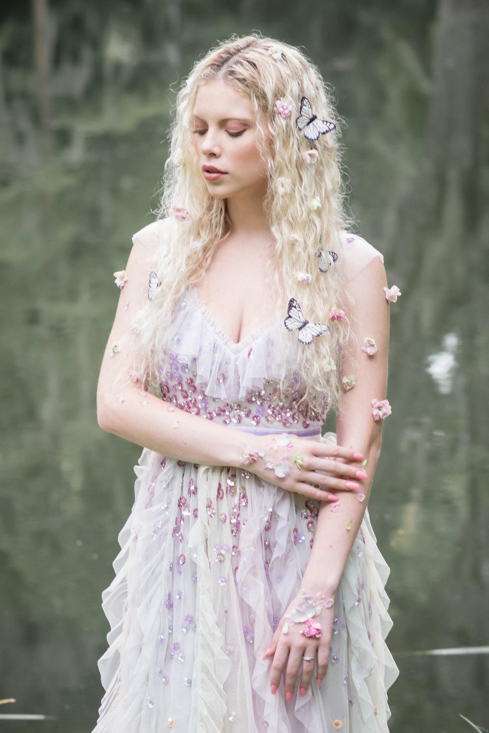 lilac bride gown with flowers and butterflies on hair and flowers on skin
