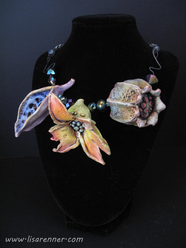 This is a Polymer Clay Pod necklace I made after taking Doreen Kassel's on-line workshop.