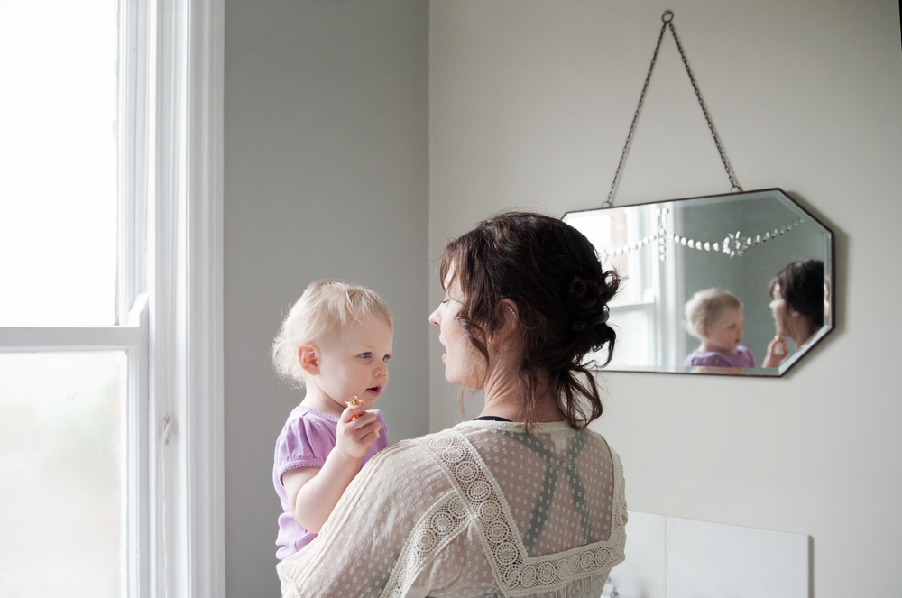 natural light photography at home mum and daughter in wilmslow