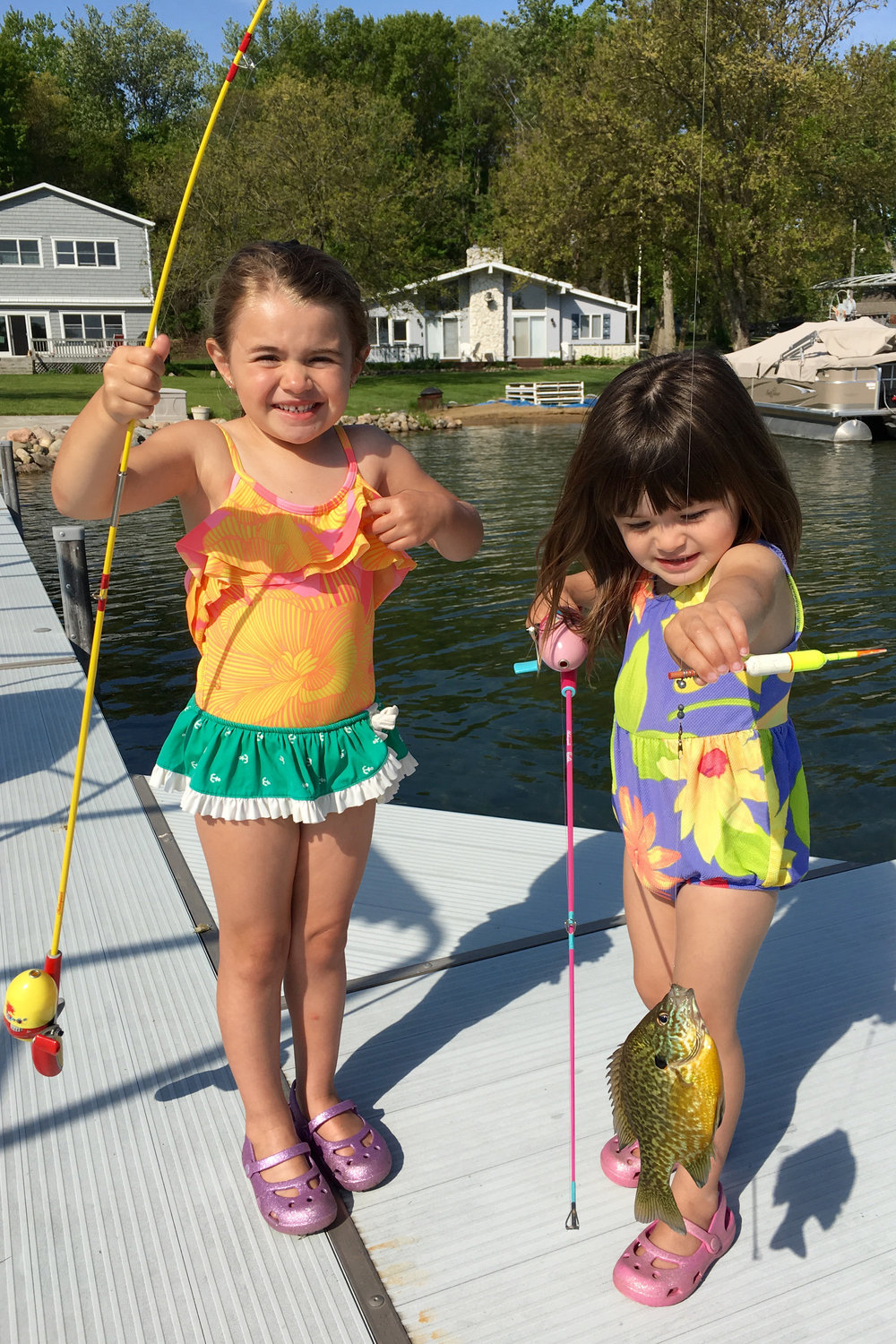 The stuff of memories: Winny Barnes (4 years) and Cami (2 years) holding pumpkinseed fish