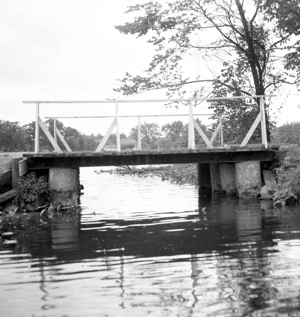 Early bridge to Maple Island, photographed circa 1920