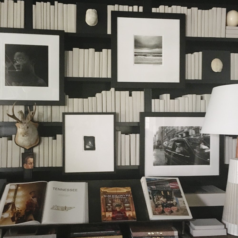 Chad James' gallery wall in The Library