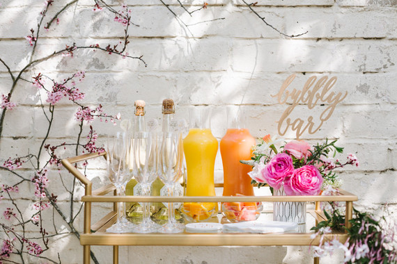 Isn't it obvious how the guests at this party are going to feel? Both bubbly and beautiful! Photo credit Alison Bernier. Styled by MV Florals.