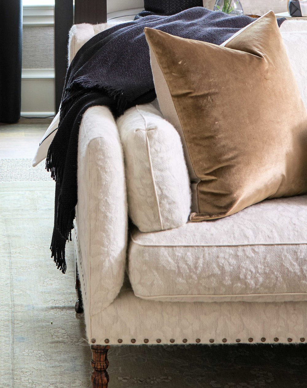 - THROWS ON ALL SEATING AREASEvery seating area is begging for a throw. If it's winter, it simply belongs. If it is summer, many people are cold in air conditioning. Plus, it just feels comfy and home-like. Go buy some throws.designers: Joel Kelly & Whitney Ray