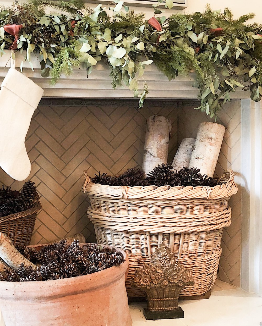 Fill the fireplace - FILL THE (NON-WORKING) FIREPLACEYou could use logs or pine cones if you are in a mountainous area or it's the holidays. But also think books, pumpkins, beach balls, etc. Love this idea of baskets and containers.designer: Lauren DeLoach