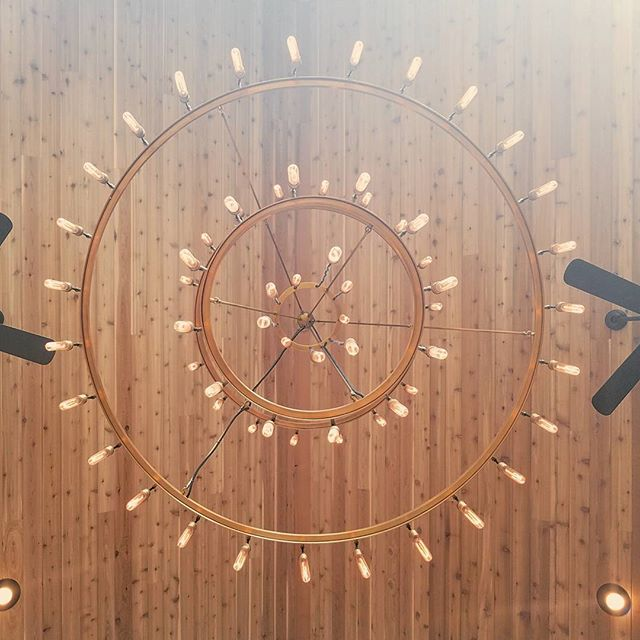 Amazing retro chandelier at a house we worked at today. #photography #perspective #chandelier #vintage #circles #wood #interiordesign #instagood #ceiling #retro
