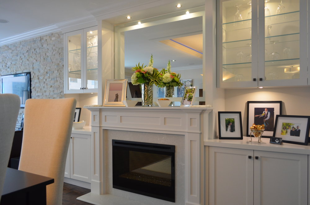 built in fireplace   Custom one of a kind fire place and wall unit in a contemporary condo reno.