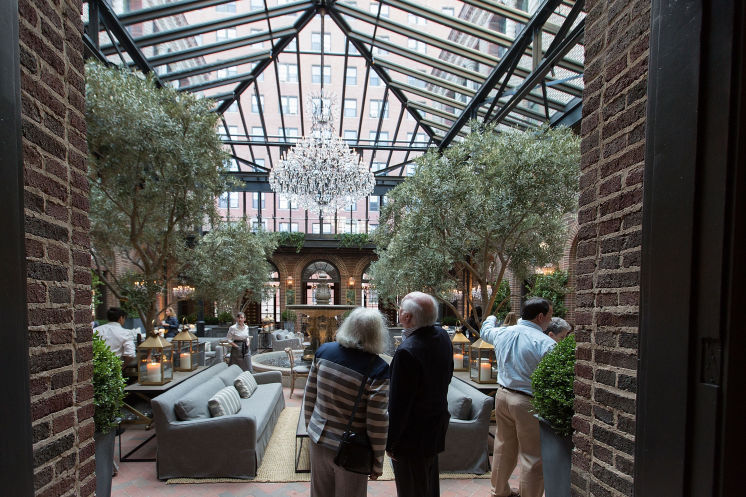 Only Restoration Hardware can pull off live trees and chandaliers