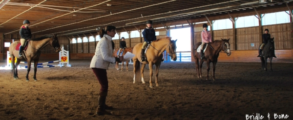 "Suzanne Hehn, a USEF ""r"" judge, provides detailed feedback to the riders in lieu of ribbons."