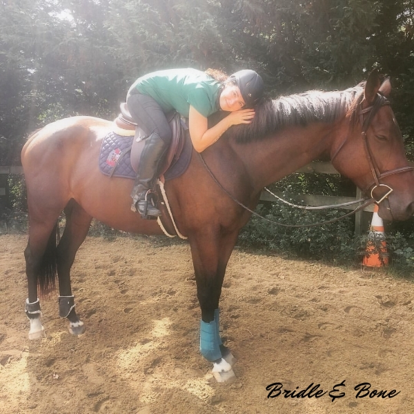 Delight and I have a quick hug during our lesson. Photo credit: Robin Brennan, Trainer extraordinaire.