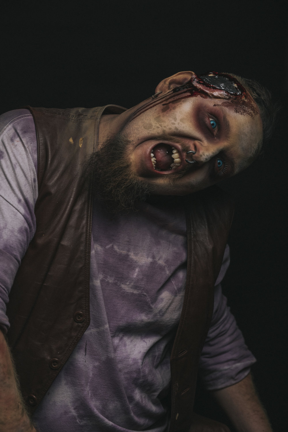 I have of course seen the Texas Chainsaw Massacre movies but I will admit to not knowing a ton about the character of Chop Top. With that said I love the way he looks. With his exposed metal plate on his head he's gets a lot of comments on the makeup.