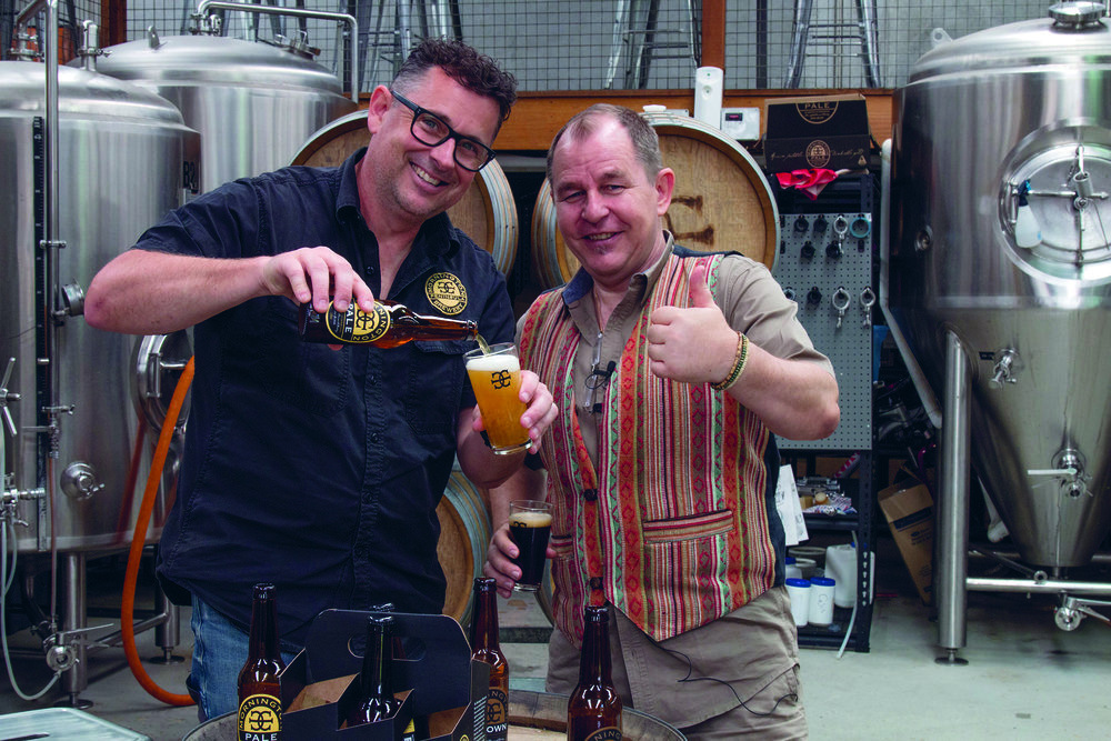 Matt Bebe, from Mornington Peninsula Brewery, pours one of his beers for Steve to sample.