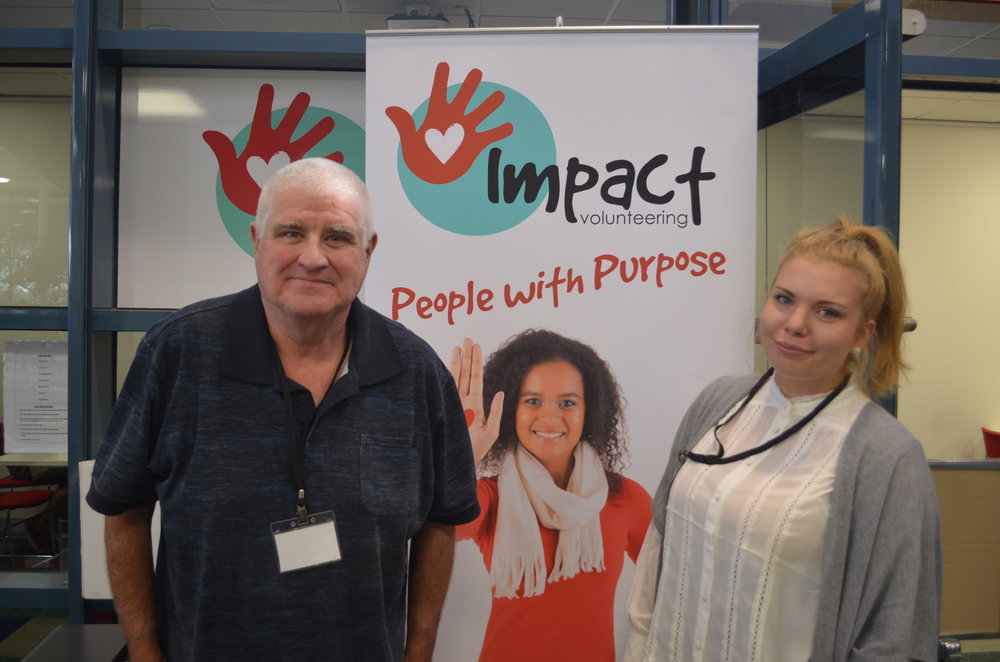 Volunteers Mark and Sharnie at the Impact Information and Referral Desk in Frankston Library.