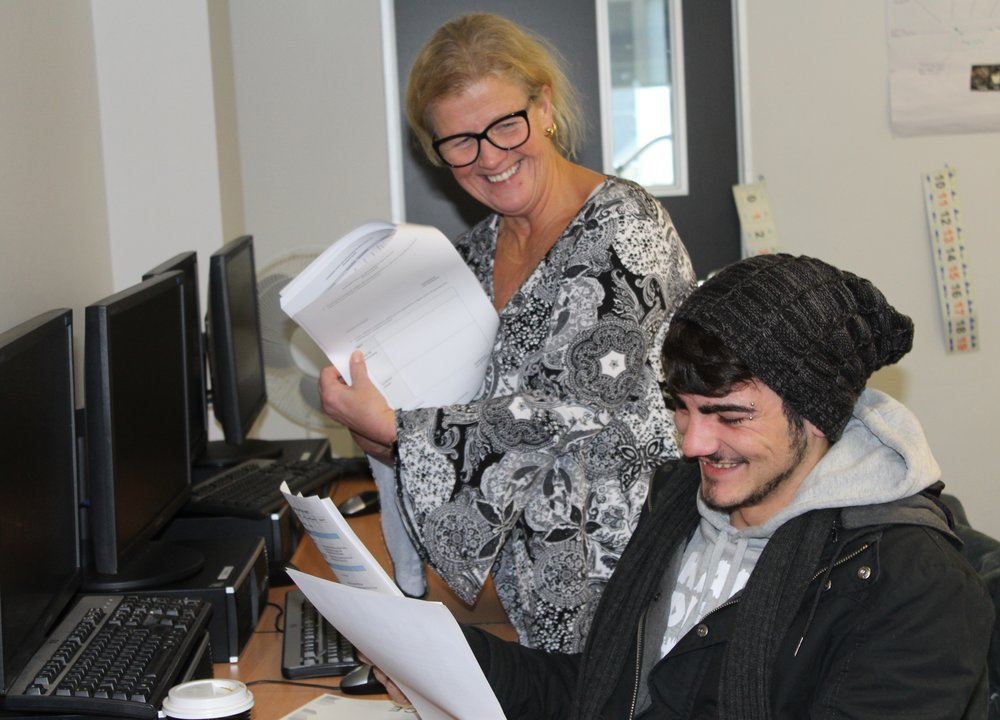 Susanne Westley, a trainer at BRACE, helps a student in the Certificate IV in Disability CHC43115 class at Frankston.