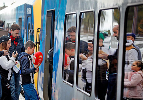 CAPTION 2 Kids getting on train 01.png