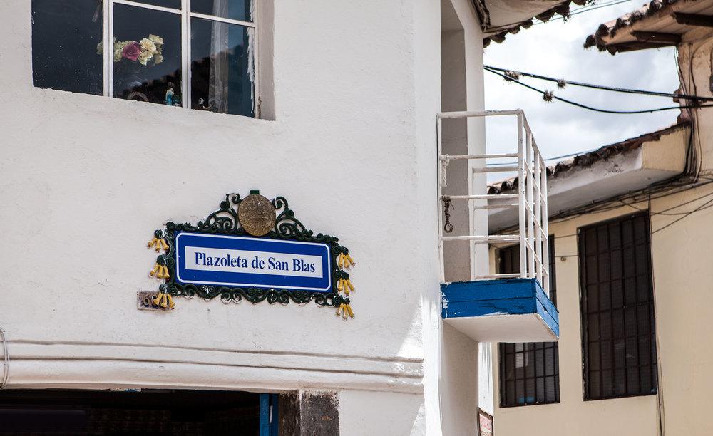 Cusco-Peru-wander-south-san-blas-plaza-sign.jpg