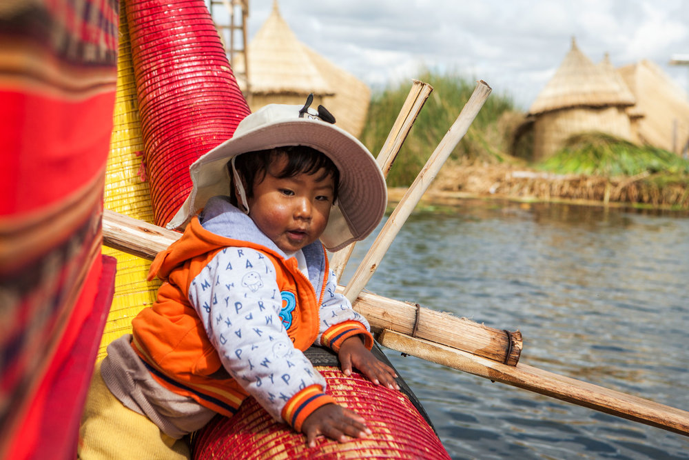 lake-titicaca-puno-peru-wander-south-reed-islands-boy.jpg