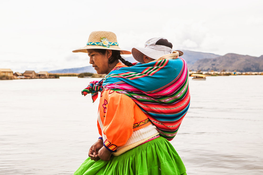 lake-titicaca-puno-peru-wander-south-reed-islands-mother-and-child.jpg