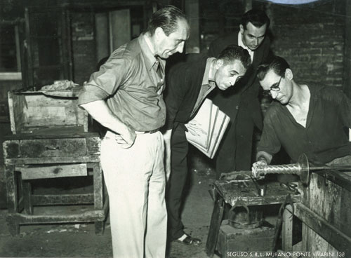 Prof. Flavio Poli (second left, holding sketches) at the ASV Barovier Seguso & Ferro workshop c.1935