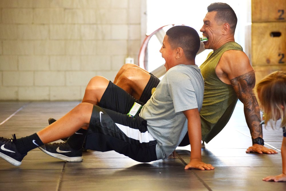 Father and son stretching.JPG