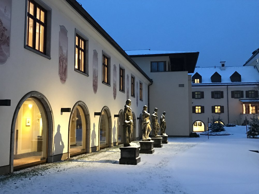 Statues lining the courtyard area at Schloss Fuschl