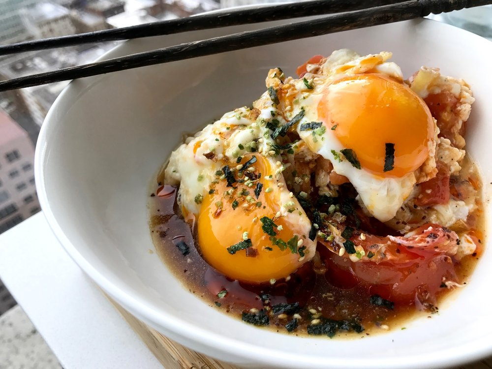 Beautifully cooked golden runny yolks sitting on top a umami bursting pool of tomato enoki broth simmered with ponzu