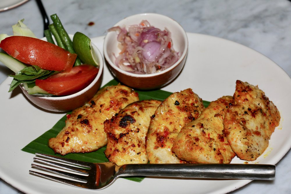 Charcoal Grilled Fish Filets marinated in Indonesian Spices.