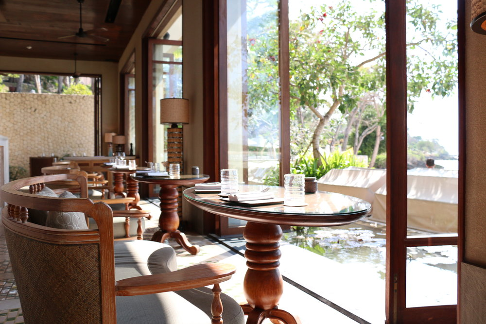Indoor dining option at Sundara that opens up to the beach view